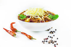 Mexican chilly con carne with meat and black beans. In a white bowl stock photo