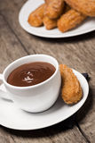Mexican Churros with Chocolate on Wooden Table Royalty Free Stock Images