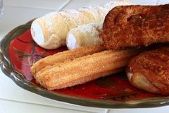 Mexican Churros with cream horns and danishes Stock Image