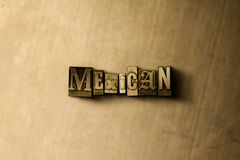MEXICAN - close-up of grungy vintage typeset word on metal backdrop Stock Photos
