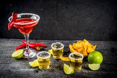 Mexican cocktail for Cinco de Mayo. Cinco de Mayo celebration concept. 5th May Mexican party`s drinks - margarita cocktail, tequila shots with lime, hot chili royalty free stock photos