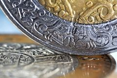 Mexican coins with a selective focus. Macro of mexican coins with a selective focus Stock Image