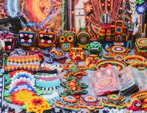Mexican colorful beaded souvenirs and handicrafts in Sayulita, Mexico. Handmade beaded souvenirs with aztec and mayan designs in Mexico. Skulls, lizards stock photography