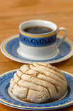 Mexican Concha sweet bread with coffee cup Stock Image