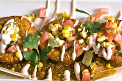 Mexican Corn Cakes. A Mexican style appetizer with salsa and fresh vegetable relish Stock Image