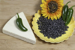 Mexican Cotija Cheese. Cheese Mexican Cotija on a plate with jalapeno peppers, black beans on a wooden board Stock Images