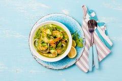 MEXICAN CUISINE. Aguachile de camaron. Prawns aguachile. Shrimps eviche cebiche with cucumber, lemon and purple onion. Top view, blue background Royalty Free Stock Images