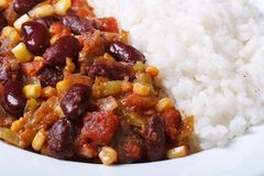 Mexican cuisine: chili con carne and rice macro Royalty Free Stock Photo
