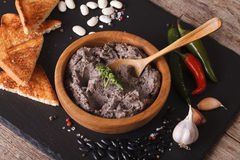 Mexican cuisine: Frijoles refritos with ingredients close-up. ho Royalty Free Stock Photography
