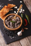 Mexican cuisine: Frijoles refritos with ingredients close-up. ve Stock Image