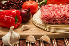 Mexican cuisine, meat and vegetables. Ingredients that are used in mexican cuisine for burrito Royalty Free Stock Photo
