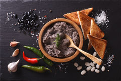 Mexican cuisine: pate of black beans on the table. horizontal to Royalty Free Stock Photo