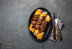 Mexican cuisine. Traditional Mexican chicken enchiladas with spicy chocolate salsa mole poblano. Enchiladas with sauce Stock Photos