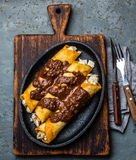 Mexican cuisine. Traditional Mexican chicken enchiladas with spicy chocolate salsa mole poblano. Enchiladas with sauce Royalty Free Stock Photos