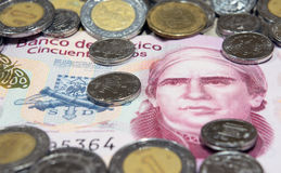 Mexican currency. Mexican coins and fifty peso note Royalty Free Stock Image