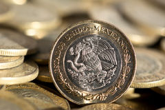 Mexican currency in the foreground, with many more coins in the background, macro, Horizontal.  stock images