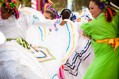 Mexican Dancers. COSTA MESA, CA - JULY 24: Unidentified Mexican dancers perform in traditional costumes on stage at the Orange County State Fair in Costa Mesa Royalty Free Stock Image