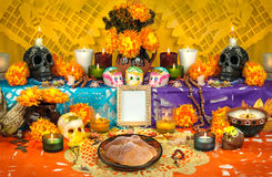 Mexican day of the dead altar Dia de Muertos. Traditional mexican Day of the dead altar with sugar skulls and candles Royalty Free Stock Photos