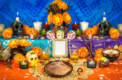 Mexican day of the dead altar Dia de Muertos. Traditional mexican Day of the dead altar with sugar skulls and candles Royalty Free Stock Images