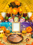Mexican day of the dead altar Dia de Muertos. Traditional mexican Day of the dead altar with sugar skulls and candles Royalty Free Stock Image