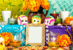 Mexican day of the dead altar (Dia de Muertos). Traditional mexican day of the dead altar with sugar skulls candles and blank photo frame Royalty Free Stock Photography
