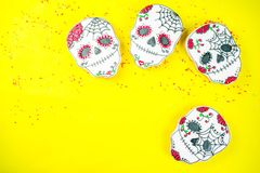 Mexican Day of the Dead cookies. Dia de Los Muertos, Mexican Day of the Dead or Halloween greeting card background with traditional colorful skull shaped cookies royalty free stock photo