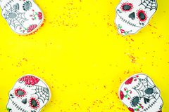 Mexican Day of the Dead cookies. Dia de Los Muertos, Mexican Day of the Dead or Halloween greeting card background with traditional colorful skull shaped cookies stock images