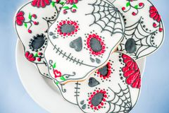 Mexican Day of the Dead cookies. Dia de Los Muertos, Mexican Day of the Dead or Halloween greeting card background with traditional colorful skull shaped cookies royalty free stock images