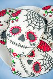 Mexican Day of the Dead cookies. Dia de Los Muertos, Mexican Day of the Dead or Halloween greeting card background with traditional colorful skull shaped cookies stock image