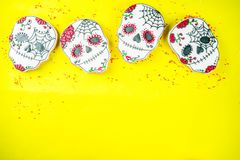 Mexican Day of the Dead cookies. Dia de Los Muertos, Mexican Day of the Dead or Halloween greeting card background with traditional colorful skull shaped cookies royalty free stock image