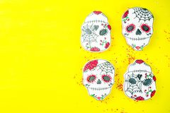 Mexican Day of the Dead cookies. Dia de Los Muertos, Mexican Day of the Dead or Halloween greeting card background with traditional colorful skull shaped cookies stock photo