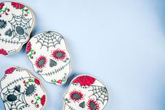 Mexican Day of the Dead cookies. Dia de Los Muertos, Mexican Day of the Dead or Halloween greeting card background with traditional colorful skull shaped cookies stock photos