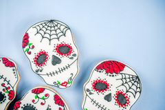 Mexican Day of the Dead cookies. Dia de Los Muertos, Mexican Day of the Dead or Halloween greeting card background with traditional colorful skull shaped cookies stock photography