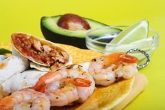 Mexican dinner. Chicken fajitas with shrimp skewer royalty free stock image