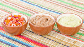 Mexican Dips & Side Dishes. Salsa, Guacamole and Refried Beans royalty free stock images