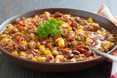 Mexican dish chili con carne in a brown pottery plate, close-up Stock Image