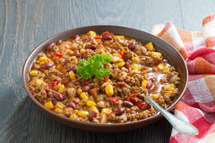 Mexican dish chili con carne in a brown pottery plate Royalty Free Stock Image