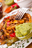 Mexican dish and guacamole Royalty Free Stock Photos