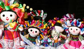 Mexican dolls. Several Mexican traditionally handcrafted dolls on a shopping window Royalty Free Stock Photo