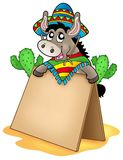 Mexican donkey with wooden table Royalty Free Stock Photos