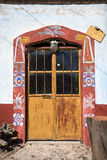 Mexican door with painted frame Stock Images