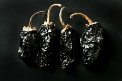 Mexican dried chili peppers black background Royalty Free Stock Photo