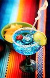 Mexican drink. A glass full of blue curacao margarita Royalty Free Stock Images