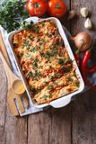 Mexican enchilada in a baking dish vertical top view Royalty Free Stock Photography
