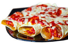 Mexican enchiladas on plate. Isolated over white Royalty Free Stock Photography