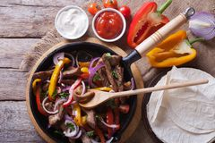 Mexican fajitas closeup, rustic style Horizontal top view Royalty Free Stock Images