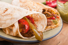 Mexican Fajitas with Guacamole. Traditional Mexican Chicken and Beef Fajitas with Guacamole Royalty Free Stock Photos