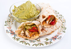 Mexican Fajitas with Guacamole. Traditional Mexican Chicken and Beef Fajitas with Guacamole Royalty Free Stock Photography