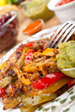 Mexican Fajitas with Guacamole. Spicy Mexican Chicken Fajitas with Guacamole Royalty Free Stock Images
