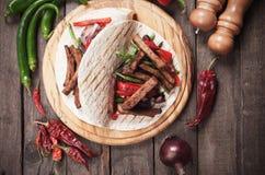 Mexican fajitas in tortilla wrap Royalty Free Stock Photography
